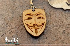 Laser cut and engraved V for Vendetta wood keyring. By TwikiConcept on Etsy