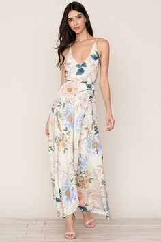 Yumi Kim's flowing Rush Hour Silk Maxi Dress in Rainforest Ivory is your new go-to from weddings to running around the city. The floral dress includes a crossover bodice with deep v-neckline, snap chest closure, self-tie waist, and cross-back adjustable s Silk Floral Dress, Silk Dress, Bridesmaid Dresses Floral Print, Printed Dresses, Floral Dresses, Butterfly Dress, Butterfly Print, Flowing Dresses, Maxi Wrap Dress