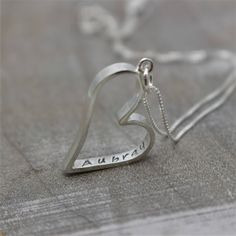 A personal favorite from my Etsy shop https://www.etsy.com/listing/154385597/personalized-sterling-silver-heart