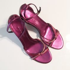 New!! Banana Republic Purple Metallic Wedge! Womens 6 1/2 Size BANANA REPUBLIC Purple Metallic Wedge High Heel Sandals. MADE IN ITALY. Brand New, never worn! Has an adjustable strap. Red, purple, gold skinny straps at the front with a knot. Banana Republic Shoes Wedges