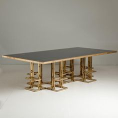 A Late 20th Century Brass Based Laminated Black Lacquer Topped Dining/Boardroom Table with Bronze Inlay (Talismanlondon.com)