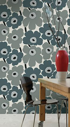 I am slightly Marimekko obsessed after a recent trip to the Copenhagen store. Would love to be daring enough for this wallpaper.