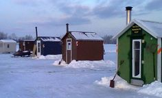 January in Maine...ice-fishing shacks on Long Lake in St. Agatha, Maine. (photograph by Jesse Pelletier)