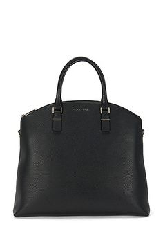 This BOSS women's handbag in naturally grained leather is characterised by its simple design and its slightly rounded shape. The gold-coloured zip provides an exclusive accent, and 2 carrying handles and a detachable shoulder strap complement the design. This leather bag makes the ideal companion for everyday business use thanks to its generous amount of storage space.