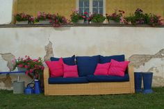 Indigo linen box cushions on a sofa, decorated with pink linen cushions.