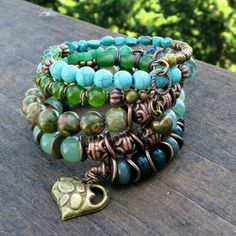 There are 2 Memory wire bracelets in this set:  ** Bracelet 1: Made with Turquoise, Green Agate, Green Apatite, Green Aventurine, Moss Agate,