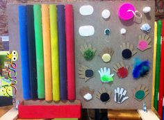 """Fun sensory & motor skill panel - post corks & pom-poms through the pipes, touch the different textures, twist & unscrew lids & identify colours ("""",)"""