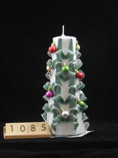 Hand Carved Candle White and Green, Christmas Tree Carve with Ornaments and Candy Canes, 7 Inch, OOAK, 1085 is available at $28.00 https://www.etsy.com/listing/492996717/hand-carved-candle-white-and-green?utm_source=socialpilotco&utm_medium=api&utm_campaign=api  #candles #pillar