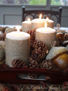 Fall Centerpiece with Burlap Wrapped Candles would be soooooo easy to make! Dollar store candle add burlap from the store.so beautiful. Fall Crafts, Holiday Crafts, Holiday Fun, Holiday Decor, Thanksgiving Decorations, Seasonal Decor, Christmas Decorations, Candle Decorations, Thanksgiving Tablescapes