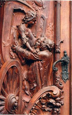 A carved wooden door in Worms, Germany.