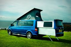 Based on the VW Transporter, the Doubleback Van is a deceptively large recreational vehicle, powered by VW's 2.0 TDI engine, and featuring an electric slide-out rear pod that adds almost six feet to the length of the vehicle when stationary, a pop-up roof that lets you walk comfortably around in the living and kitchen areas, and the ability to function as a regular van during those times when you need something a bit more practical.