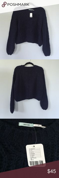 Kimchi Blue Bella Pullover Sweater Brand new sweater, with tags, never been worn before!! It is a size XS but is loose fitted/slouchy so it could fit a S as well. It is a dark navy blue color with knit details. Super cute sweater ✨ Urban Outfitters Sweaters Crew & Scoop Necks