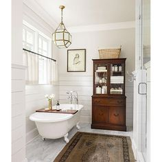 Instagram media countrylivingmag - An antique china cabinet makes an unexpected statement in this beautiful bathroom  (: Lincoln Barbour) #homedecor #decorating