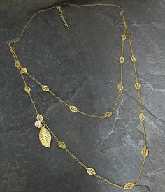 Check out this item in my Etsy shop https://www.etsy.com/listing/96743900/layered-gold-necklace-set-gold-leaf