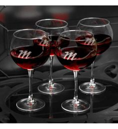 Specially designed for that favorite red vintage, our quartet of four personalized red wine glasses will please the wine connoisseur in your life. Attractively personalized with a modern script-style monogram, these glasses are delicate but sturdy and make a great bridesmaid or housewarming gift. Cheers!