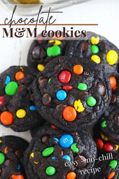 Chocolate M&M Cookies are an easy no-chill cookie recipe. Packed with colorful M&M's and super soft and chewy - perfect for any occasion. Made super dark without food coloring - making them perfect for holidays like Halloween.