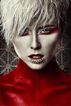 """Painted"" with striking silver & red make-up accented by bejeweled lips and crystals."