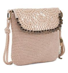 Add a touch of glam to your casual look with the Kearny medium crossbody in alabaster sequins. Featuring our signature crochet, the flap closure is also lined with bronze toned sequins.