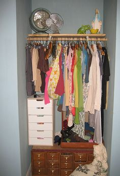 """""""closet in february,"""" by happify, via Flickr -- """"My winter clothing, such as it is... Library card catalog came from a good family friend and holds girly supplies, wash cloths, and rolled-up pants."""" -- This is different!"""