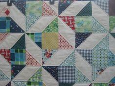 The squares are a combination of multiple fabrics from DS Quilt lines and some matching charm squares. Description from squaresandtriangles.com. I searched for this on bing.com/images