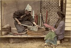 Sword sharpener practicing his trade with a customer
