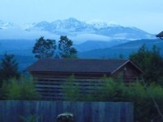 The view from home with the Olympic Mountains.