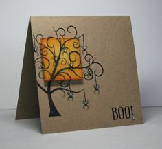handmade Halloween card ... kraft base ... stylish tree image with a plethora of hanging spiders ... each with jewel body ... luv how the small orange sponged  square is popped up but perfectly continues the lines of the tree ... Hero Arts