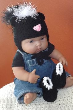Skunk hat and booties set by NutHouseKnots on Etsy