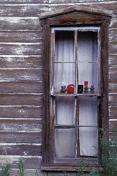 Window, Madrid, Santa Fe County, New Mexico; photo by Erik Pronske