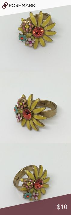 🆕Vintage Enamel and Rhinestone Adjustable Ring A fabulous flower child ring in yellow, blue and pink with bright rhinestones. Set in an antiqued gold setting. Adjustable from size 6 up. In very good vintage condition, only 1 small crack in the enamel on one petal, but this ring has stood the test of time! I love this piece, just an amazing example of vintage enamel! Vintage Jewelry Rings