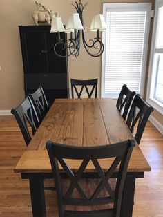 "This 6' x 37"" Farmhouse Table in Early American stain on top and Black painted base pairs stunningly with 6 Double X Back Chairs.   Solid Wood Furniture, Custom Built Furniture, Shop Local, Garage Started Business, Solid wood Chairs, Solid Wood Table, Dining Room Table, Dining Room Decor, Dining Room Chairs"