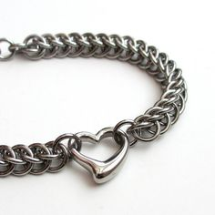Stainless steel chainmail bracelet with 3D heart by TattooedAndChained, $40.00