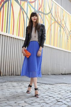 blue and orange! also, love the combo of tough leather and girly pleated midi. this is fantastic.