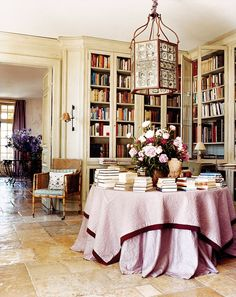 A lantern from Westenholz Antiques in the bright library inside Janet de Botton's home in the South of France.