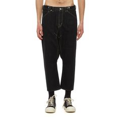 Low crotch denim pants from the S/S2017 Ganryu collection in black These denim pants from Comme des Garçons Ganryu new collection comes in an oversized fit. The low crotch trousers, here in black denim, are made of cotton and features five pockets, an adjustable waistband from the inside and a zip and button closure.  - Low crotch pants - Five pockets - Adjustable waistband - Composition: 100% Cotton - Made in Japan  - Code: ES-P020-051-1 - The model is wearing an international S size