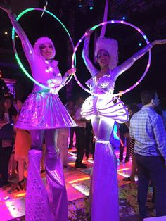 Our female stilt characters are all lit up with their LED accessories and props!  Hora loca, ISES Houston, House of Blues, corporate event, J&D Entertainment www.jdentertain.com
