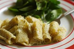 Rigatoni with Cheesy Pesto - this recipe calls for Parmesan and goat cheese (but you could substitute cream cheese instead if you're not a fan of goat cheese).  This would be great as a simple one dish main meal simply by adding in cooked rotisserie chicken or cooked, sliced Italian sausage.