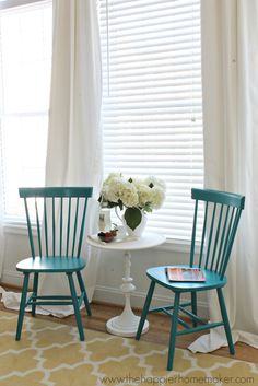We love sitting areas - and the peacock blue chairs are perfect next to a bright white table. #PutTogether