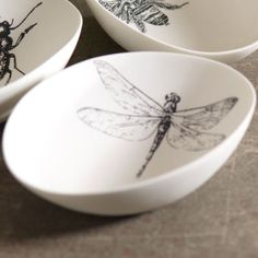 White porcelain bowls with intricate dragonfly designs. Sister would love these.      Product: BowlConstruction Material: Porcelain