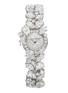 Montre haute joaillerie Harry Winston http://www.vogue.fr/joaillerie/shopping/diaporama/montres-haute-joaillerie-diamants-full-pavees/16442/image/884395#!montre-haute-joaillerie-harry-winston