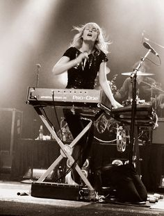 Emily Haines- been looking for a pic like this for a while since I went to a Metric concert and thought it was so awesome how she managed to sing, dance, and play two synthesizer keyboards at once. She is just awesome.