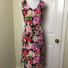 "Lilly Pulitzer Flower Market Dress Lilly Pulitzer black Flower Market sleeveless v-neck sheath dress. Mid-calf length. Multi-color floral, 95% Silk, 5% Spandex. Hidden back zipper. Chest pit to pit 19 1/2"", Waist 16"" across, Length 42"". Gently worn. Lilly Pulitzer Dresses"