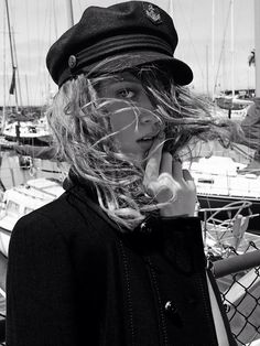 Pretty curls under sailing cap.   TheyAllHateUs