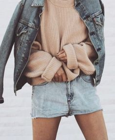 faded jean shorts, oversized sweater, and jean jacket. casual cute and cozy summer outfit.