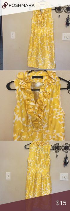 The Limited yellow and white dress. Very nice. Yellow and white dress with ruffled v-neck. In great condition. Very flattering. Size 6. Side zipper. Bought it from a fellow posher but fit a little to snug on me. The Limited Dresses