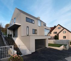 """German architectural firm Ippolito Fleitz Group has designed the Haus F in Denkendorf, Germany. Completed in 2008, this 3,229 square foot contemporary home features a minimalist design. The highlight of the open living area is the large L-shaped window with a heated ledge. Haus F by Ippolito Fleitz Group: """"The view from the L-shaped panoramic window over the 900 year old village of Denkendorf, with its abbey in the centre, attracts everyone's attention. The heated window l..."""