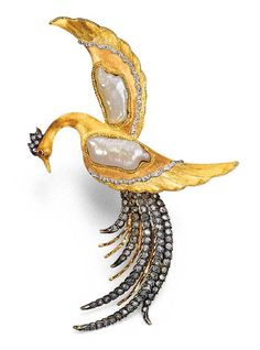 AN ELEGANT BAROQUE CULTURED PEARL, DIAMOND AND GOLD BIRD OF PARADISE CLIP BROOCH    The realistically crafted brushed gold ruby-eyed bird, each wing set with a baroque cultured pearl to the rose-cut diamond tail, 11.8 cm. high