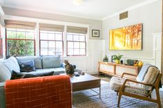 Their bright living room. The credenza is from Room and Board and they have an amazing screensaver for their TV that constantly changes scenes and includes falling leaves and sound effects.