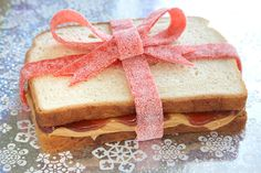 Peanut butter and Jam sandwich tied with a sour ribbon.