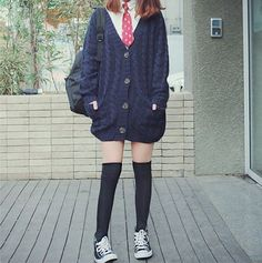 Cute ulzzang outfit. White collared long sleeves. Red polka dotted tie. An oversized knitted cardigan. Knee-high socks. Sneakers.